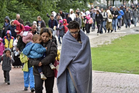 Germany's Merkel faces political crisis over migrant policy