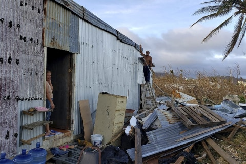 For U.S. islands' guest workers, storm recovery happens without government cash