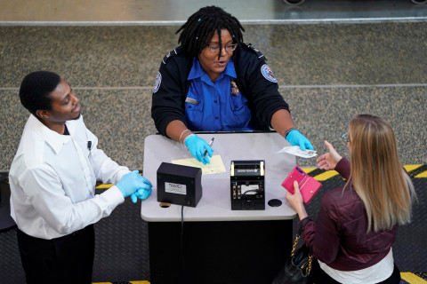 With government shutdown threatening paychecks, more TSA agents calling out sick