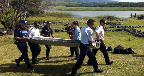 French Investigators Check Plane Debris on Remote French Island for Clues in MH370 Hunt