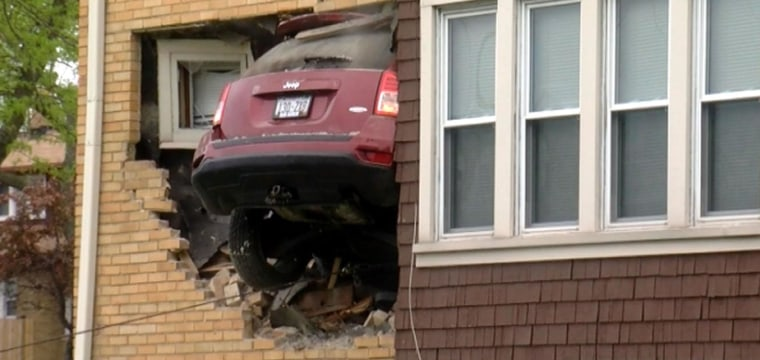 Jeep Slams Into Home After Going Airborne