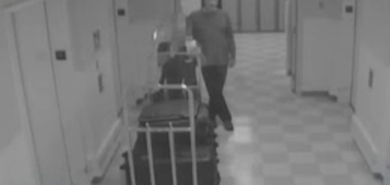 Surveillance video shows Vegas gunman bringing weapons to hotel room