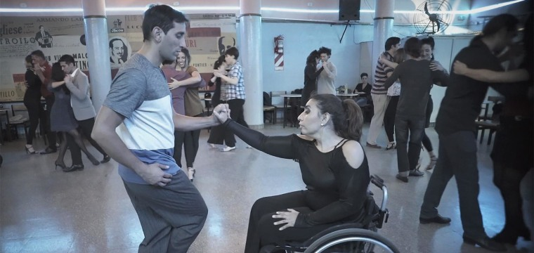 Dancing tango with grace, and in a wheelchair