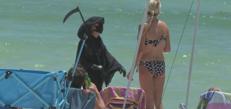 Man dresses as Grim Reaper to warn Florida beachgoers about coronavirus