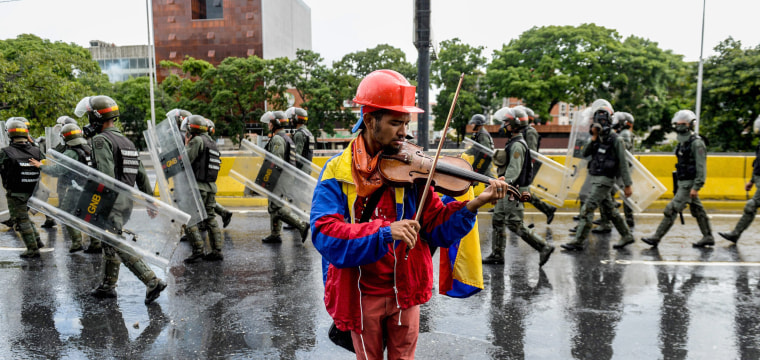 Venezuela Crisis: Violinist Wuilly Arteaga Bloodied During Street Protest