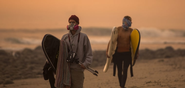 California surfers brave wildfire smoke to catch waves