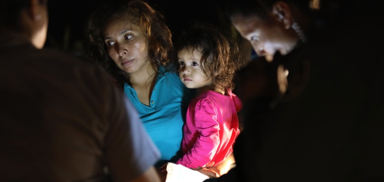 A day at the border: Gripping images show detained migrant families