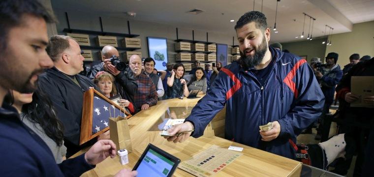 Massachusetts makes history as first legal marijuana shops on East Coast open Tuesday