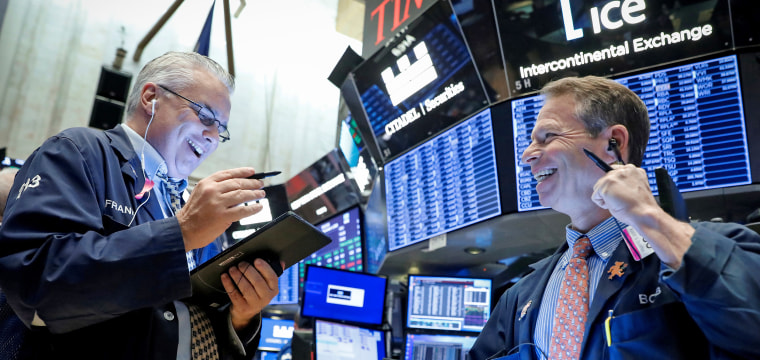 Dow jumps 200 points to record high after reports China and U.S. will lift some tariffs