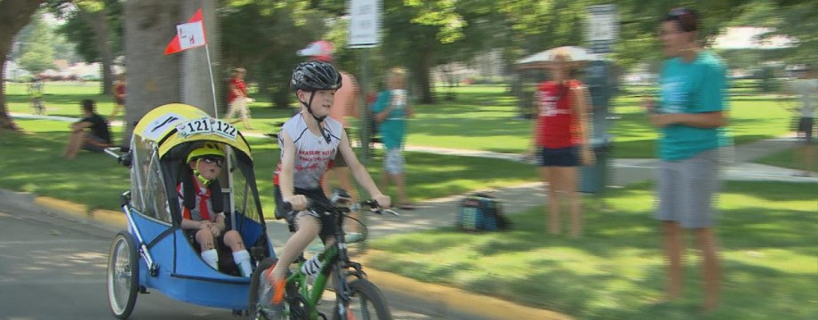 8-Year-Old Triathlete Refuses to Leave Brother Behind