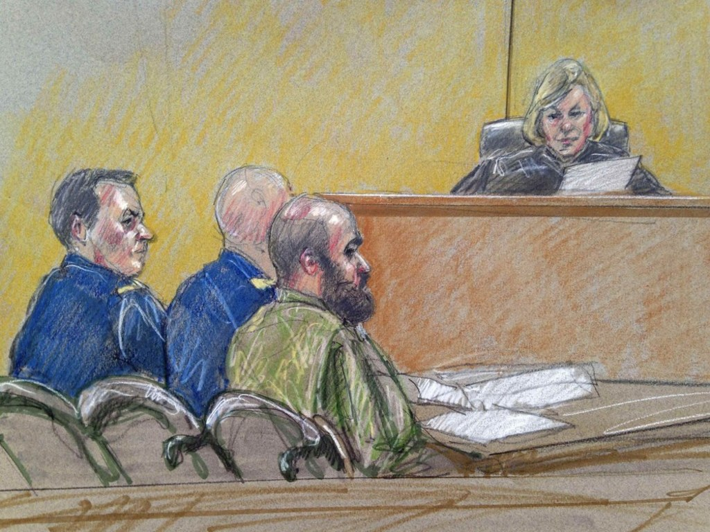 U.S. Army Maj. Nidal Hasan, center, accused of killing 13 soldiers in a  2009 Fort Hood shooting rampage, is seen in a courtroom sketch as he sits  with his ...