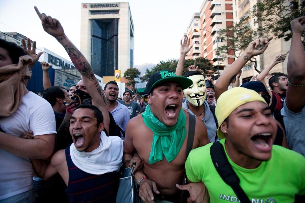 Image: Opposition demonstrators shout slogans against the National Bolivarian Police