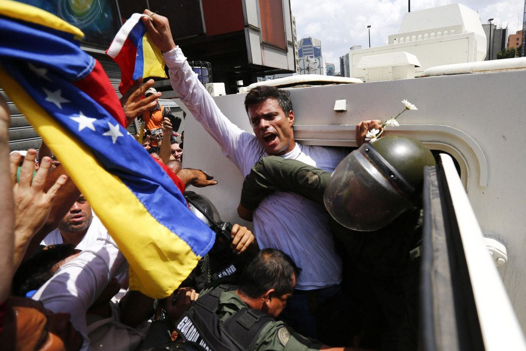 Image: Venezuelan opposition leader Leopoldo Lopez gets into a National Guard armored vehicle in Caracas