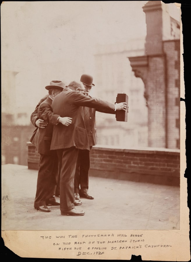 Image: Five photographers pose together for a selfie in 1920.