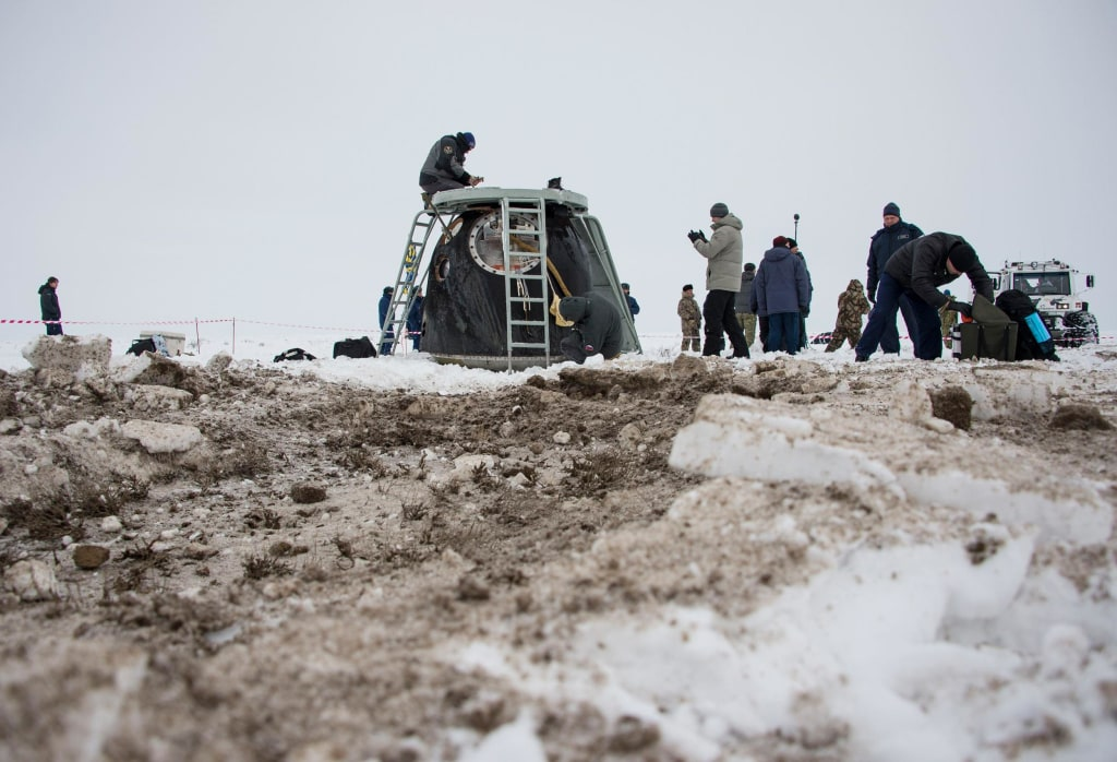 Image: The Soyuz TMA-10M capsule is seen shortly after it landed with former ISS commander Kotov and flight engineers Ryazansky and Hopkins from NASA onboard in a remote area southeast of Zhezkazgan