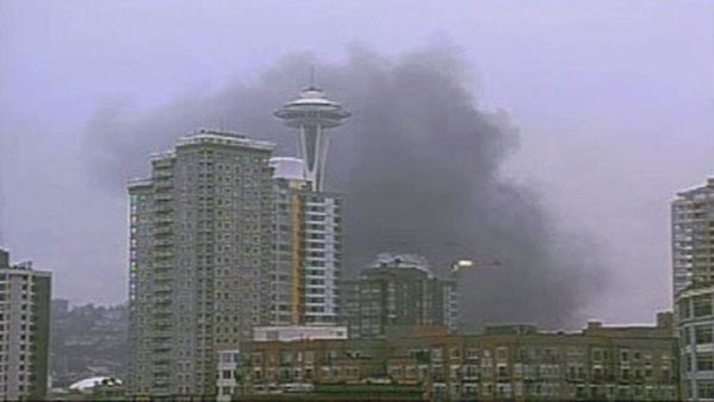 Smoke rises near the Space Needle in Seattle after the crash of a news helicopter