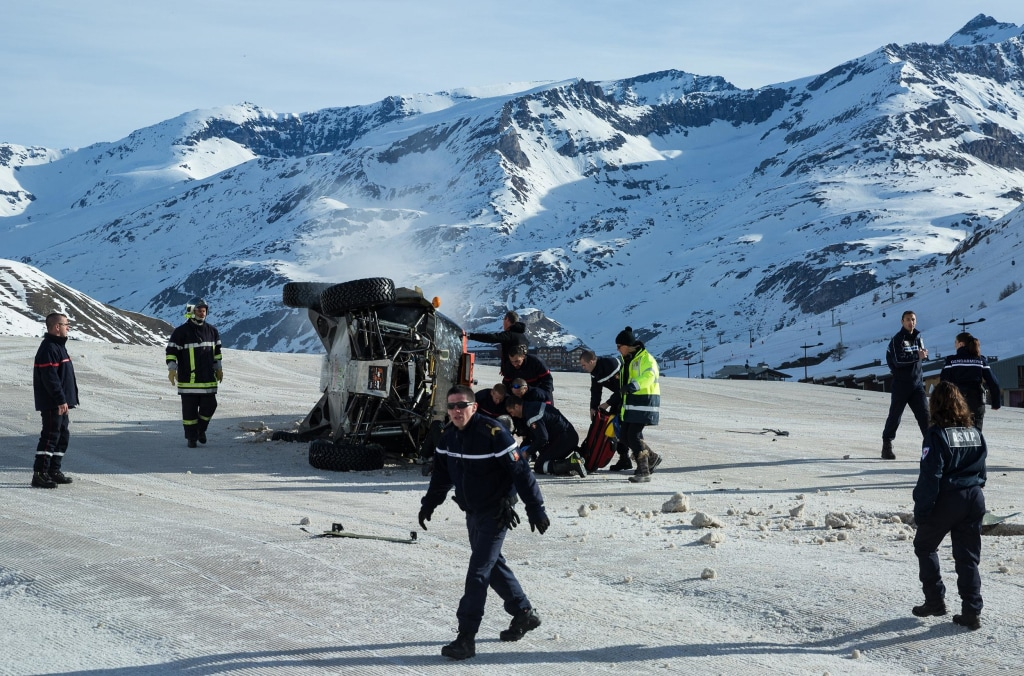 Image: Guerlain Chicherit receives help after crashing his car during his attempt at breaking the World Record for the Longest Car Jump