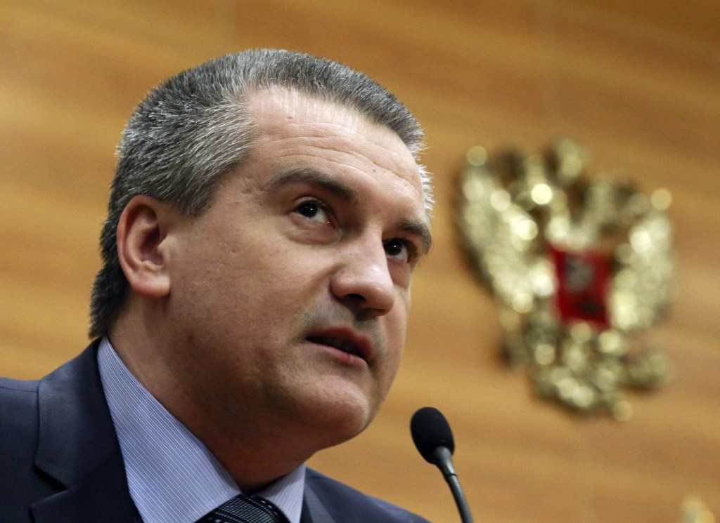 Image: Crimean Prime Minister Sergei Aksyonov delivers a speech during a meeting of deputies of the State Duma, Russia's lower parliament house, with members of the Crimean parliamentary delegation in Moscow