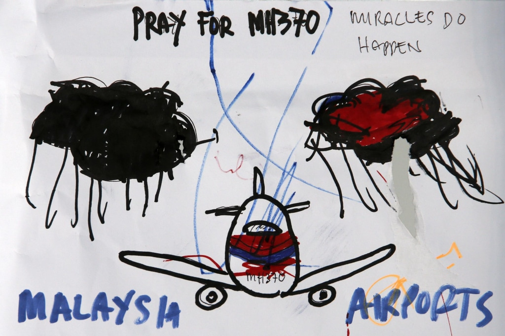 Image: An artwork conveying well-wishes for missing Malaysia Airlines Flight MH370 is seen in Kuala Lumpur International Airport