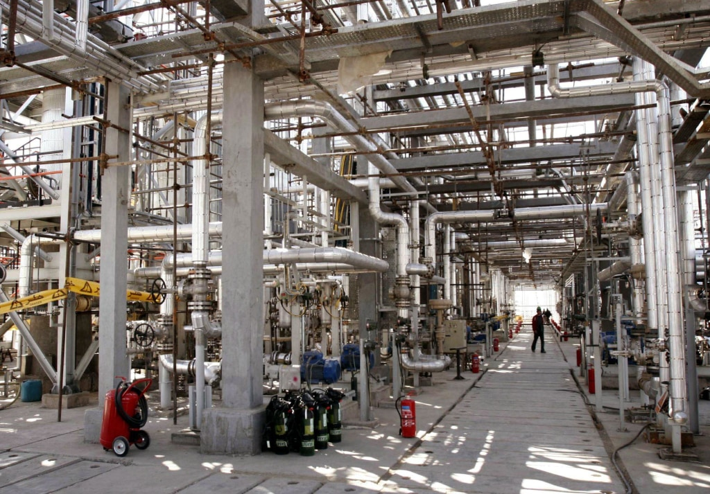 Image: A worker walks through a maze of pipes at the Arak heavy water production facility in central Iran in 2004.