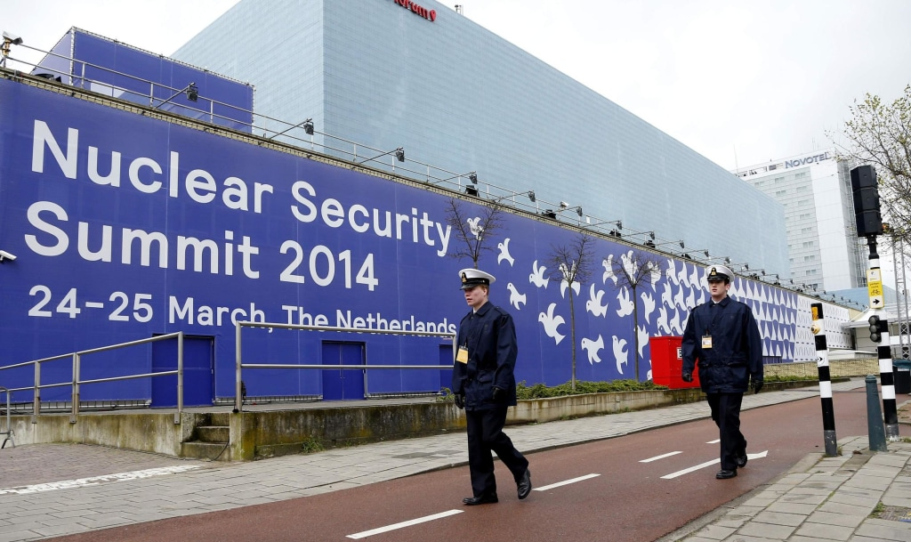 Image: Dutch Navy guards patrol near the World Forum building where the Nuclear Security Summit will take place in the Hague