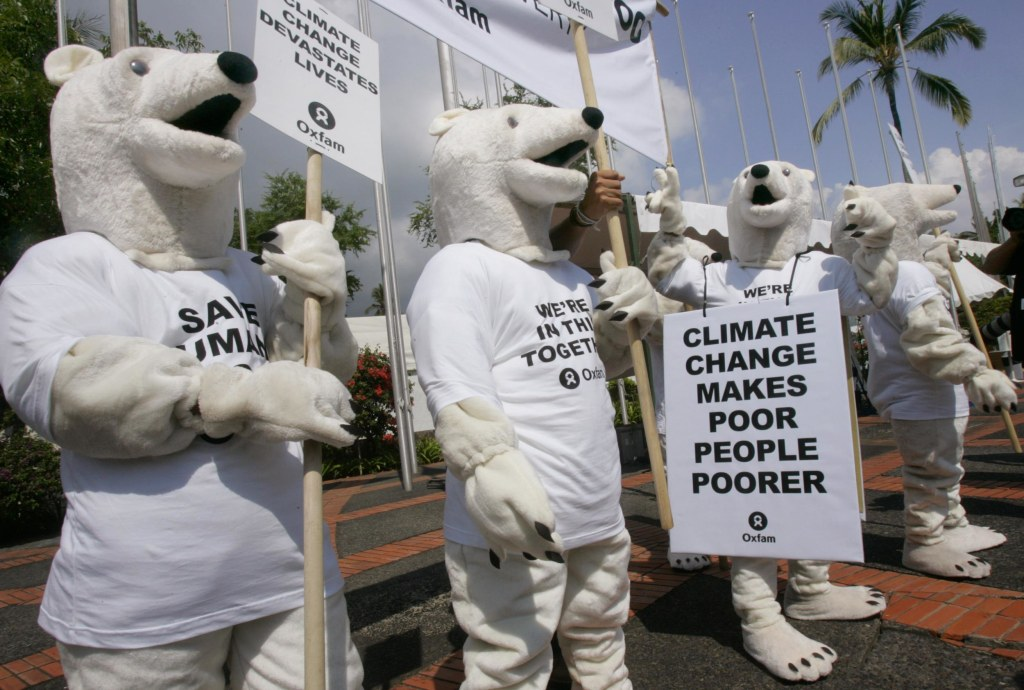 Oxfam activists wearing polar bear costumes stage a demonstration outside the venue of the U.N. climate change conference