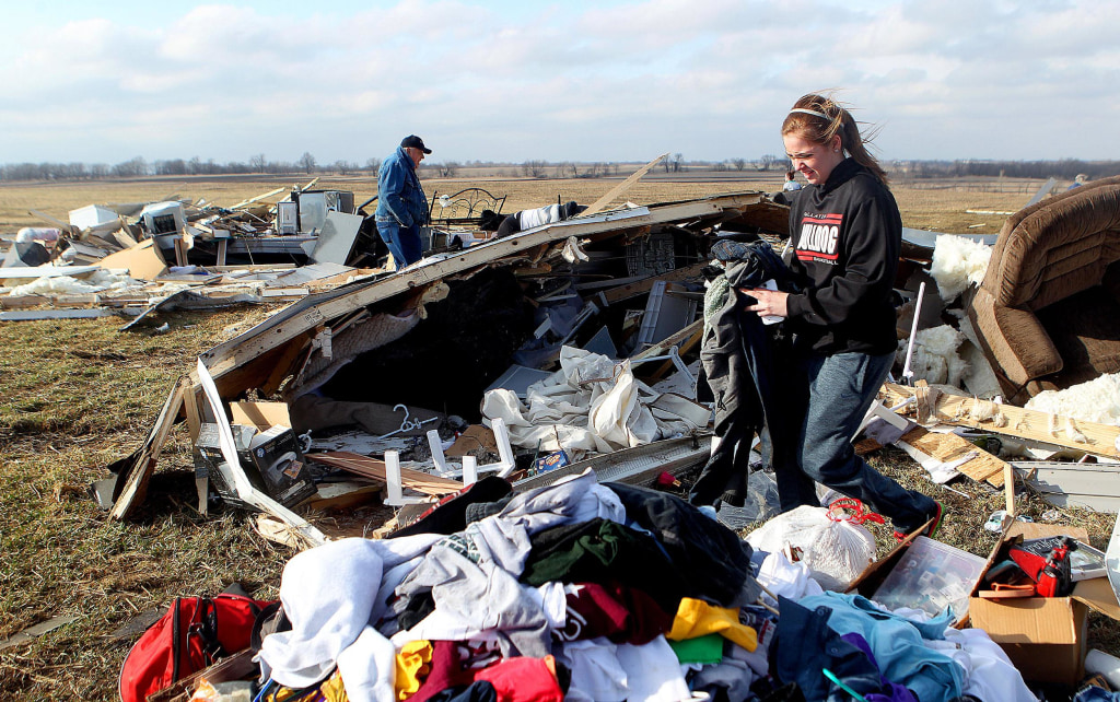 Image:Cora Stout helps recover clothing and other items