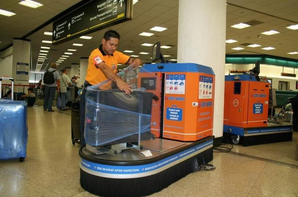 All Wrapped Up Travelers Pay To Protect Luggage With
