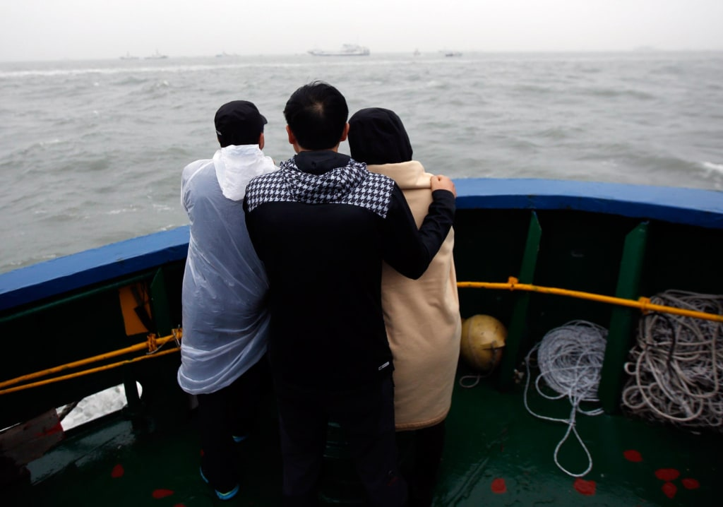 Image: Family members of missing ferry passengers