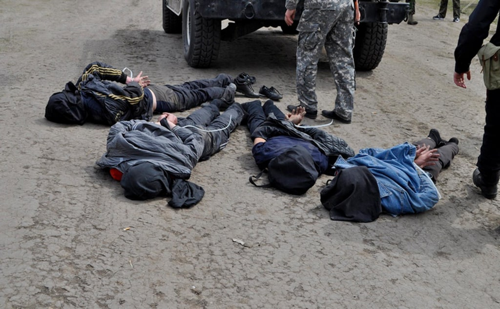 A photo released by Ukraine's Defense Ministry on Friday showed four people that it said were arrested near Slavyansk for allegedly shooting down helicopters.