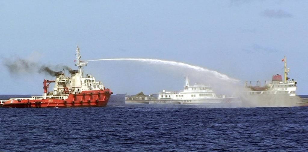 Image:  Chinese ship, left, shoots water Wednesday at a Vietnamese vessel