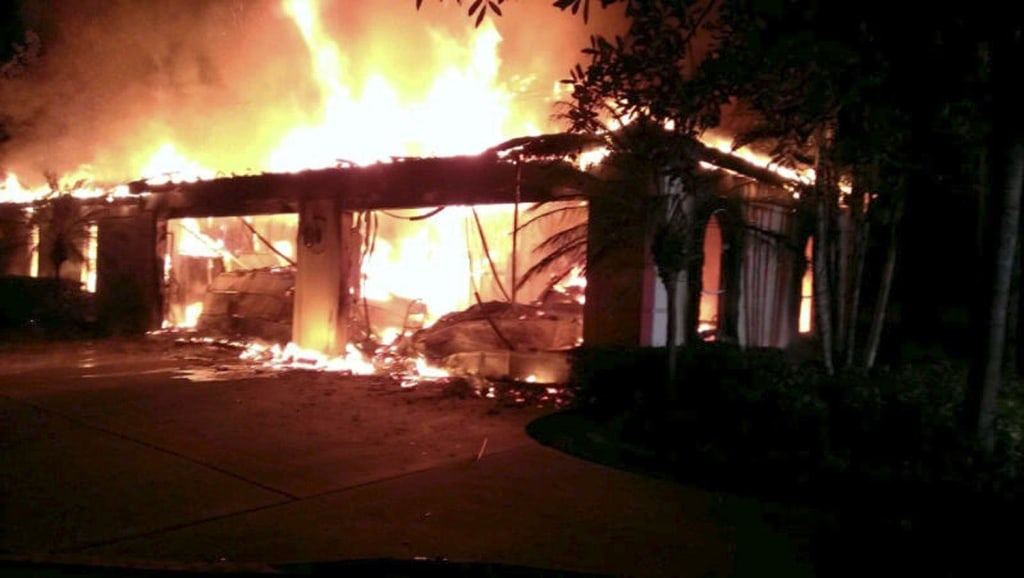 Image: Flames engulf a house owned by former tennis pro James Blake