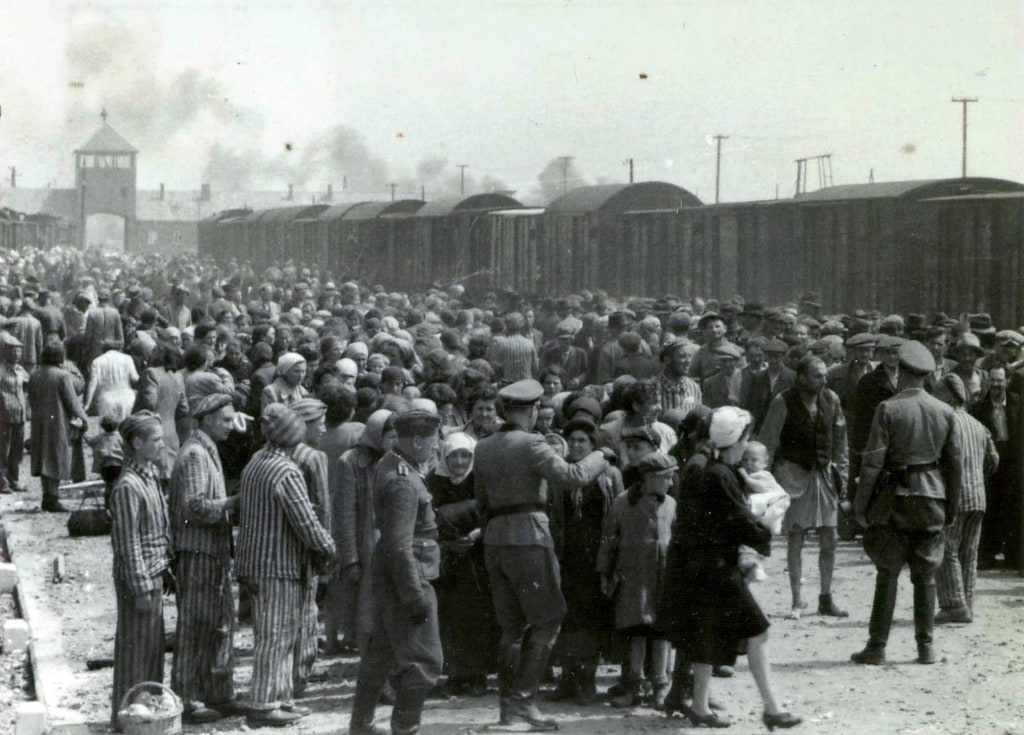 Image:  A train carrying Jews arrives at Auschwitz in May 1944