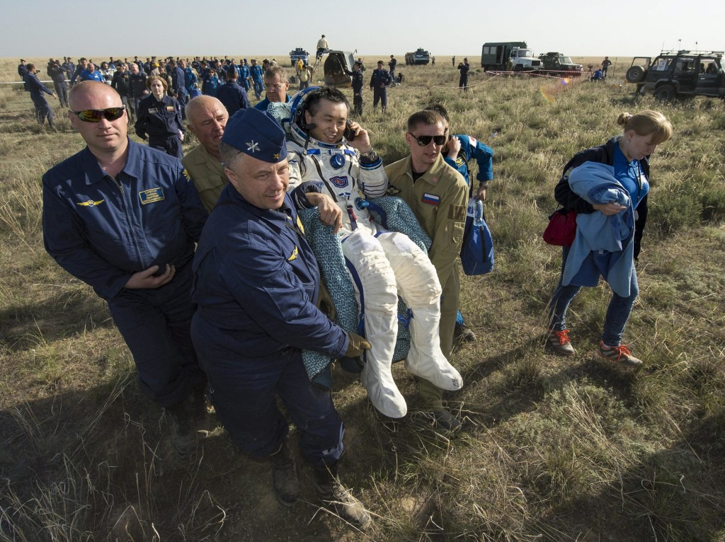 Image: Expedition 39 Commander Koichi Wakata is carried in a chair to a medical tent just minutes after landing in a Soyuz spacecraft.