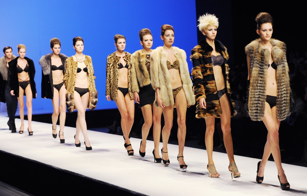 Models parade on the catwalk during Beijing's Fashion Week in 2012.