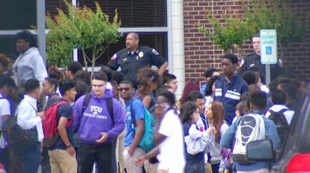 Image: More than 160 Duncanville High School students are returning to school a day after a dress code crackdown sparked outrage with students and parents