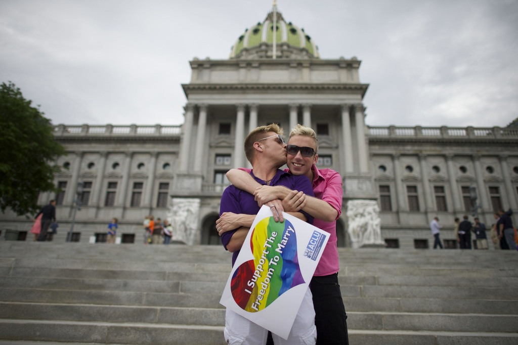 Image: A couple embraces on the Pennsylvania State Capital steps following a rally with gay rights supporters in Harrisburg