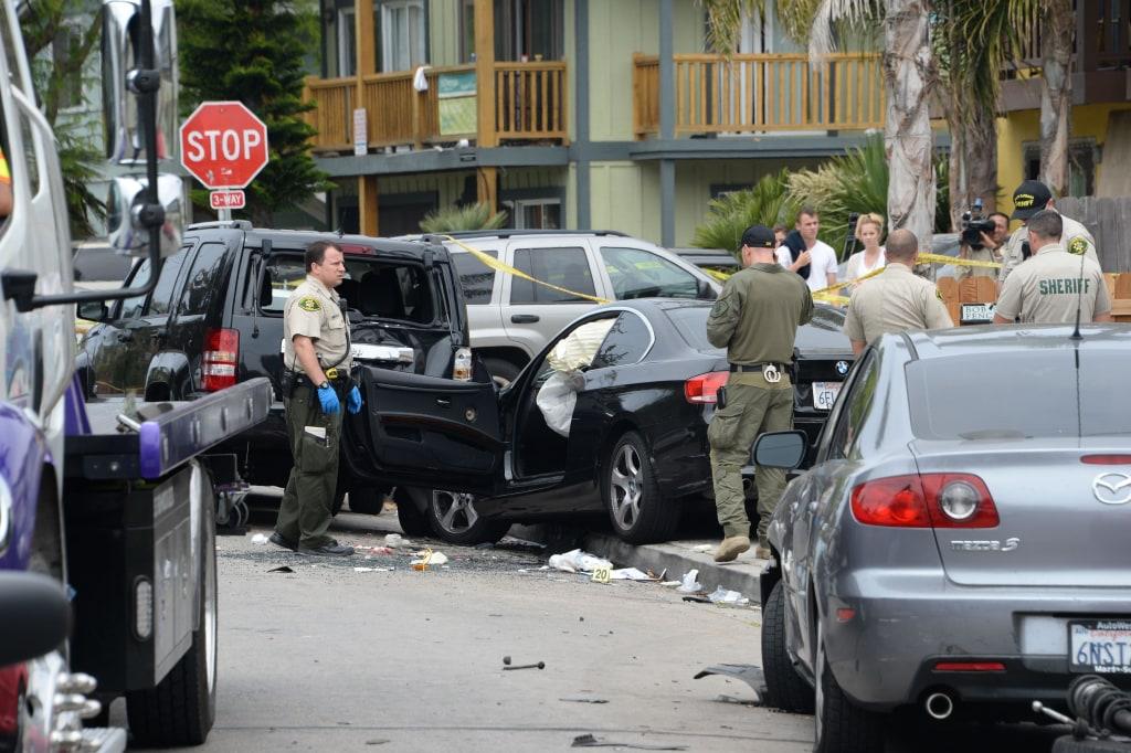 Image: Investigators inspect the suspected gunman's car