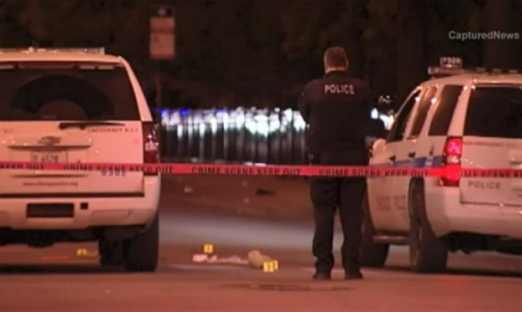 Image: Police investigate the scene of a shooting in Chicago on Saturday.