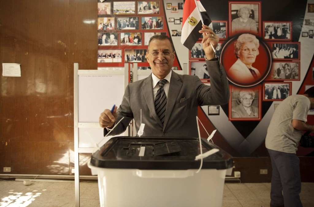 Image: An Egyptian casts his ballot for President