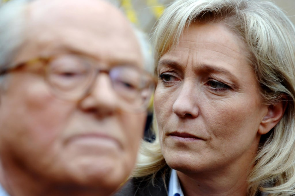 Image: Marine Le Pen listens to her father Jean-Marie Le Pen