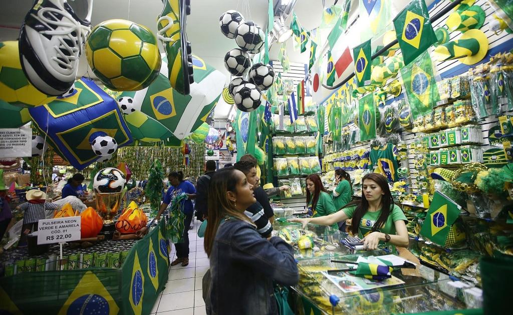 Image: People shop for Brazilian soccer memorabilia on June 10, 2014, in Sao Paulo, Brazil.