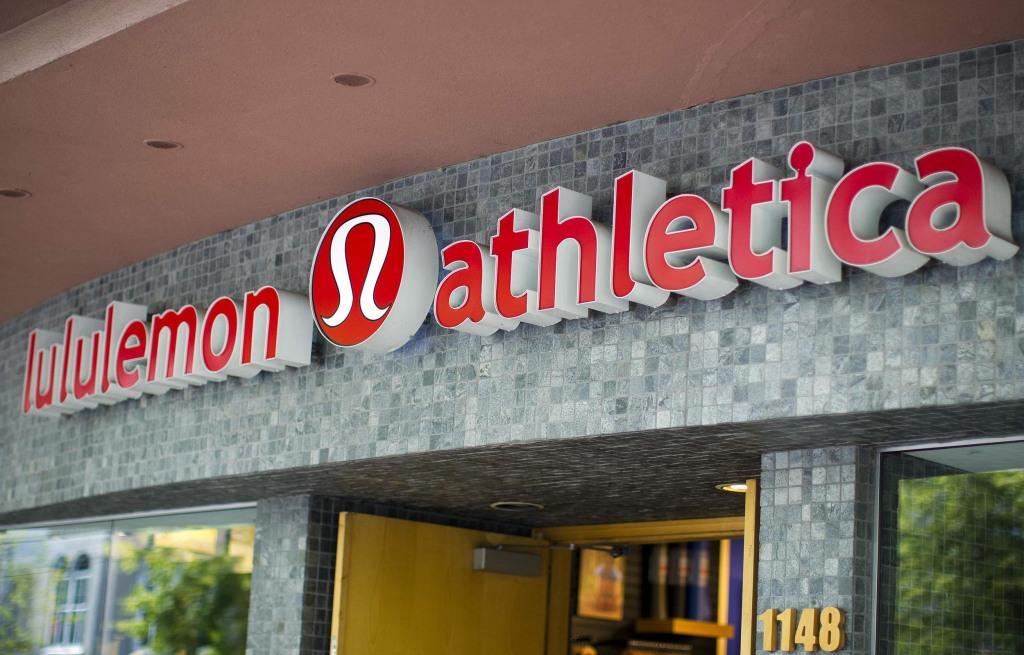Yoga wear maker Lululemon Athletica slashes it revenue and earnings forecast for the year.