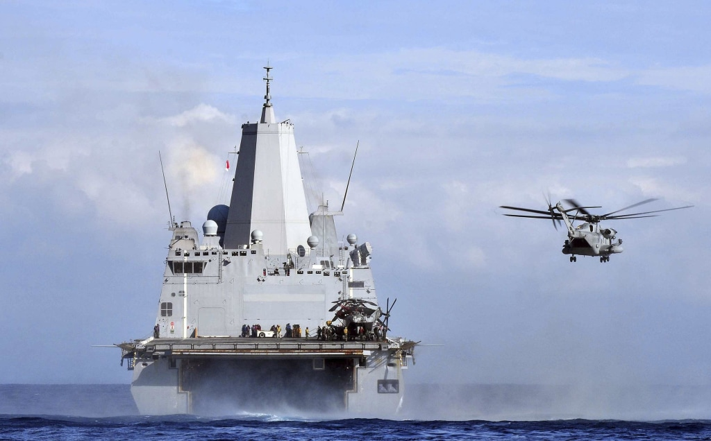 Image: A CH-53 Sea Stallion helicopter launches from the amphibious transport dock ship USS Mesa Verde in the Mediterranean Sea
