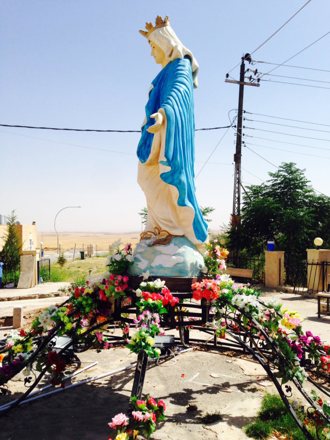 Image: A statue of the Virgin Mary is seen in Al-Qosh, an Assyrian Christian town in northern Iraq, about 30 miles north of Mosul.