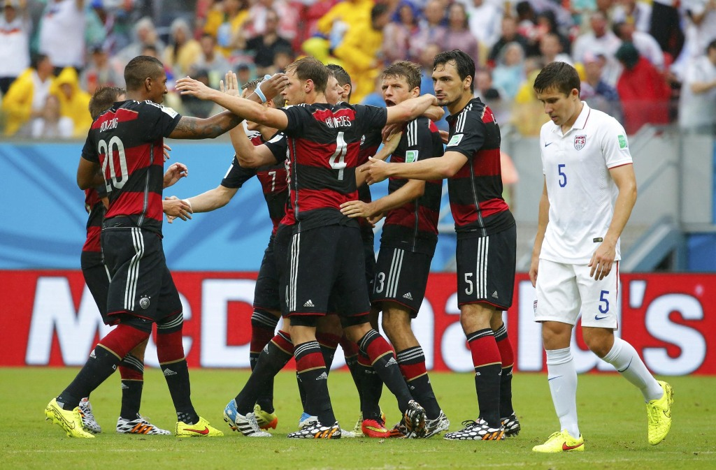 Image: Germany's Mueller celebrates after scoring a goal with teammates as Besler of the U.S. walks past during their 2014 World Cup Group G soccer match at the Pernambuco arena in Recife