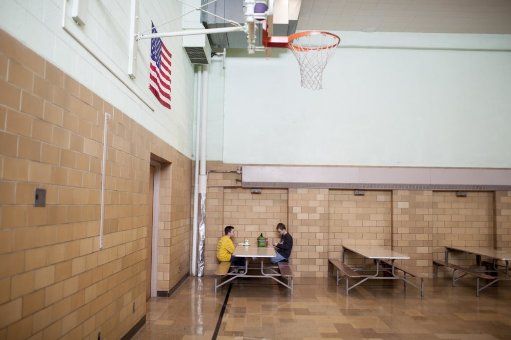 Image: Two students sit in the cafeteria of Cyrus' elementary school in Minnesota