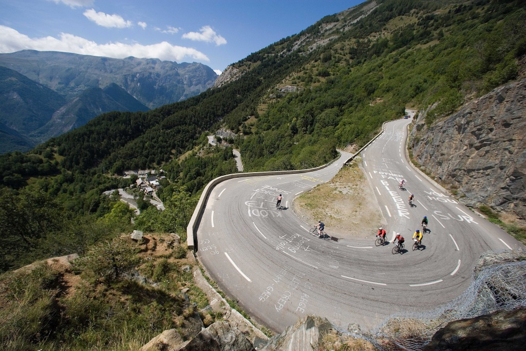 Image: Trek Travel riders navigate a switchback turn in the Alps.