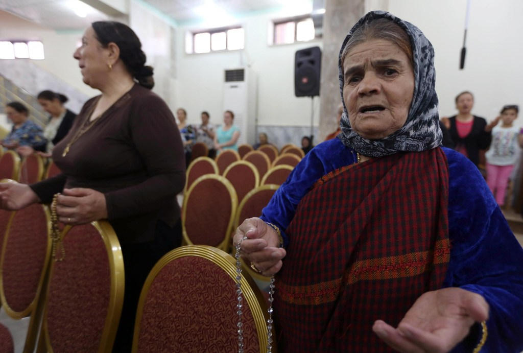 Image: Iraqi Christians who fled the violence in the northern city of Mosul
