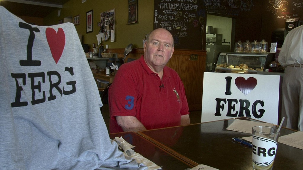 """Image: Brian Fletcher, who was mayor of Ferguson from 2005 to 2011, started a group called """"I Love Ferg."""" He's collected thousands of dollars from local residents to buy lawn signs to """"counteract the incorrect information that's being given out nationally"""
